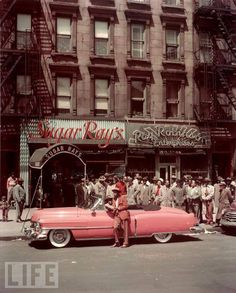 U.S. Boxer Sugar Ray Robinson leaning on his 1950 pink Cadillac convertible in front of two of his businesses (including restaurant) in Harlem (124th St. and 7th Ave.) // (Photo by George Karger/Pix Inc./Time & Life Pictures/Getty Images)