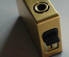 A rare gold-plated Braun TFG 1 Permanent table lighter, designed by Reinhold Weiss in 1965.