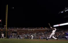 The best photos of the 2014 San Francisco Giants - Posey hits the two-run homer in the 9th inning against CO Rockies 8/27.