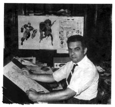 A photo of Jack Kirby circa 1966. That's the cover to FANTASTIC FOUR #54 hanging up behind him