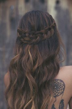 Dark brunette hair with low lights and a crossed Dutch braid