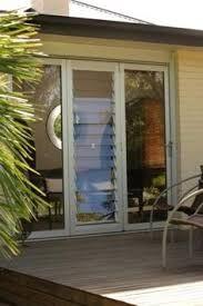 Bifold doors with louvres Louvre Doors, Louvre Windows, Front Doors With Windows, Casement Windows, Aluminium French Doors, Wooden Front Door Design, Sunroom Windows, Cabin Doors, Sliding Glass Door