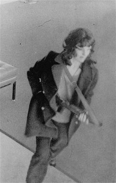 Patricia Hearst (1954-) was an heir to the Hearst newspaper empire when she was kidnapped by the Symbionese Liberation Army in 1974. She is seen here taking part in a bank robbery with her captors. Hearst announced she had joined the SLA and taken a new name, Tania.