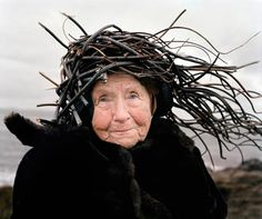"""When I am old I shall wear sticks on my Head.  But seriously, this elderly Finnish woman could make a useful head covering of this """"nest"""" by weaving in other materials to create a warm hat that has a lot of stability in wind or movement.  This is something to remember if you're ever lost outdoors and need to cover the body for warmth."""