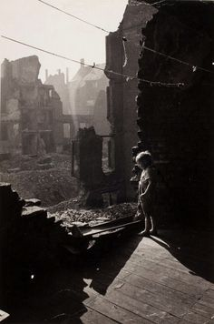 David Seymour - A boy amid devastation in Essen, Germany, 1947. From We Went Back: Photographs From Europe 1933-56 by Chim