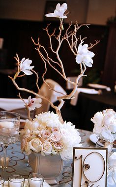 DIY #Wedding Centerpiece - White Flowers on simple #branches - would look great with #butterflies added too - so beautiful!