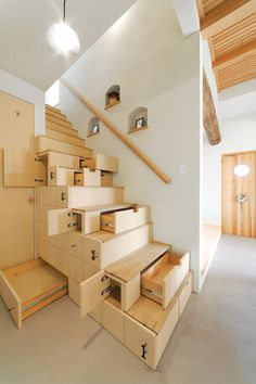 "In traditional Japanese houses, clever carpenters often combined staircases with storage to maximize living space. This project in Fukushima Prefecture inspired Nihonmatsu-based architect Kotaro Anzai to borrow the approach and create a custom-built kaidan dansu, or staircase cabinet, to connect the living room to the second story of a 1,078-square-foot home. ""We were able to create a clean, uncluttered space, but in a playful way,"" says Anzai."