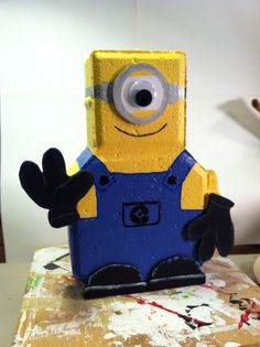 """My Minion from the movie """"Despicable Me""""! My granddaughter's idea! Brick Crafts, Concrete Crafts, Wood Crafts, Painted Pavers, Painted Bricks, Minion Craft, Crafts To Sell, Diy Crafts, Patio Blocks"""