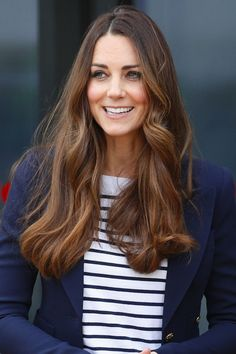 Setting the bar high for summer style, Kate wore long, '70s style waves and a striped shirt when she attended a Sportaid event at the Copper Box Arena in the Queen Elizabeth Olympic Park.  - GoodHousekeeping.com