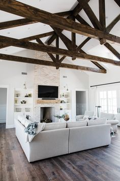 Great room with custom exposed beam detail designed and built by Rafterhouse. Located in sunny Phoenix, AZ.