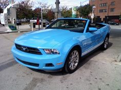 blue mustang convertable. @Laurel Draper. Ya like this one?