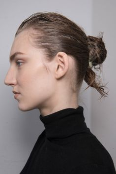 At the Anne Sofie Madsen show models wore a wet look with hair scraped into a messy low chignon.