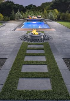 Modern backyard firepit area  rectangle pool  Rinox Zuko Grande slab