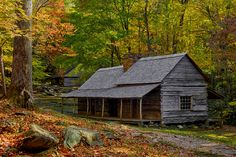 """Tennessee Homecoming - This 19th century """"saddlebag"""" cabin with two living areas that share one chimney is found south of Gatlinburg Tennessee. A four-pen barn rests on the hill."""