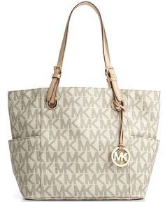"""$198 MICHAEL Michael Kors Handbag, Signature Tote - - Macys. Imported * Coated canvas; trim: leather MICHAEL Michael Kors Bag Double handles with 8"""" drop No closure All-over logo print; shiny gold hardware; side slip pockets; hanging MK logo charm Interior features center zip compartment; back zip pocket; open slip pocket; cell phone pocket; key fob 16"""" W x 11"""" H x 5"""" D"""