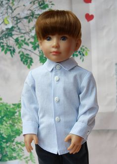 """This smart traditional Kidz n Cats dolls shirt has been sewn by me, using one of my own pattern and designs. It is made from cotton chambray in blue/white stripes. The pattern is also available for download from my shop.  It may fit other slim shaped dolls of a similar size e.g. Carpatina 18"""" doll  This listing is for the shirt only and does not include my Doll.  Comes from a Pet Free and Smoke Free Environment  If ordering from outside the UK please allow for extra delivery times. I will…"""