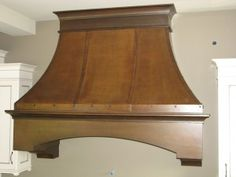 This isn't a copper range hood, it's plywood with a faux finish of plaster, paint and glaze... want to make it!