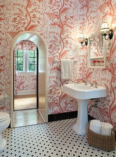 """A splendid white and cranberry toile, """"Bird and Thistle,"""" a documentary fabric and wallpaper from Brunschwig & Fils, black and white tile floors"""