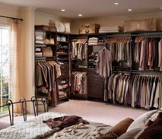 This custom dressing room from ClosetTailors.com is loaded with tons of shelving, pull- out baskets, shoe racks, a hamper, and many other storage accessories.
