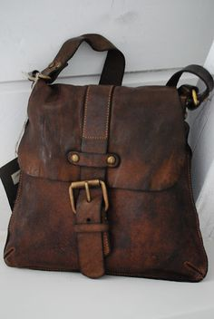 dark worn leather messenger bag, cute antiqued buckle   #hat #belt #bag