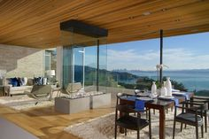 Collapsible NanaWalls showcase the Tiburon home's extensive views, while its great room revolves around a floor-to-ceiling Accucraft gas fireplace wrapped in glass. Photo: Vince ValdesPhotography