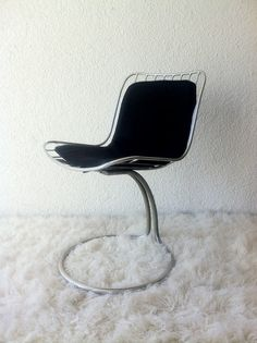chair with restored stell structure with black seat