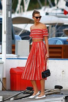 Karlie Kloss wearing Jimmy Choo Lockett Bag, Paul Smith Lovell Sunglasses in Spotty Tortoise, Christine Alcalay Linen Pleated A-Line Skirt, Repetto White Cendrillon Ballet Flats and Christine Alcalay Linen Stripe Off the Shoulder Top