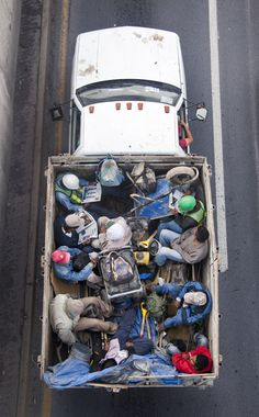 Alejandro Cartagena's 'carpoolers'... a great series of photographs depicting the everyday travels of suburban Mexicans.