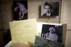 Photos and documents of German-born theoretical physicist Albert Einstein on display at the Albert Einstein Archives department at the Hebrew University in Jerusalem. The Hebrew University has expanded the free online archive of Einstein's documents to 80,000.