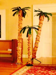 "Wilderness Escape VBS Palm trees. Carpet rolls, paper bags, 4"" rolls of foam insulation sprayed green and cut like leaves and floral wire. Wilderness escape VBS"