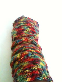 Started knitting another set of fingerless arm warmers with varigated yarn.