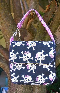 Delores' Creations - Glitter Black Skulls Pink Bow Lunch Bag, $24.00 (http://www.delorescreations.com/glitter-black-skulls-pink-bow-lunch-bag/)