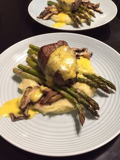 Filet mignon over mashed potatoes, asparagus, and shiitake mushrooms. - Imgur