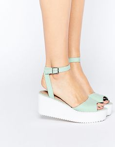 A pair of flat wedge sandals.