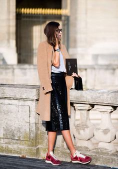 Shop this look on Lookastic:  http://lookastic.com/women/looks/coat-crew-neck-t-shirt-clutch-midi-skirt-athletic-shoes/4911  — Camel Coat  — Grey Crew-neck T-shirt  — Black Leather Clutch  — Black Leather Midi Skirt  — Burgundy Athletic Shoes