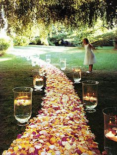 Backyard Wedding. I love the idea of the large vases filled with water or flowers.