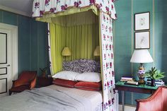 Jeffery Bilhuber's colorful vision for this New York City bedroom combines an acid-green bed corona, a malachite-topped side table and patterned teal cloth wall coverings