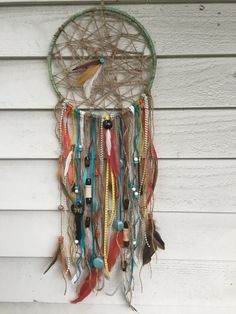 This Hippie Chic dream catcher is made with twine for a beautifully rustic element. Choose your hoop size and center webbing style: Traditional