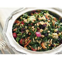 Rainbow silver beet with pine nuts, garlic and raisins recipe - By Australian Women's Weekly, Delicious and nutritious, this beautifully warm salad makes the ultimate side dish to any dinner spread. The combination of fresh rainbow silver beet, crunchy pinenuts and sweet raisins goes perfectly together.