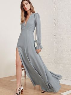 This is a floor length dress with a plunging v neckline, open back and long sleeve.