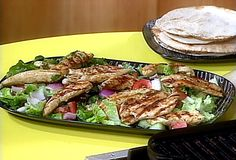 SO GOOD -- Get this all-star, easy-to-follow Greek Grilled Chicken and Vegetable Salad with Warm Pita Bread for Wrapping recipe from Rachael Ray