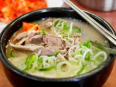 Sulleongtang is oxtail broth that goes perfectly with a side of kimchi. It's made with stewed oxtail, glass noodles, and scallions.