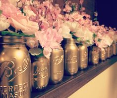 Antique gold painted mason jars with pink and blush flowers for my sister's Springtime in Paris baby shower.