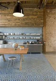 Pretty great modern use of encaustic tile as floor and wall.   Loft design by Shubin + Donaldson  from apartment therapy.