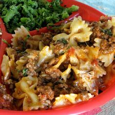 1½	lbs. lean ground beef 1	onion, chopped 1	clove garlic, minced 1	(15 oz.) can tomato sauce 1	can stewed tomatoes 1	tsp. oregano 1	tsp. Italian seasoning salt/pepper 10	oz. frozen spinach, thawed , 16	oz. bowtie pasta, cooked ½	cup parmesan cheese, shredded 1½	cup mozzarella, shredded