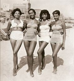 Four women on the beach in the 1950s - 50 Vintage Fashion Photos That Show How Awesome People Used To Dress  Best of Web Shrine