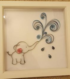 This baby elephant piece makes a wonderful addition to any nursery wall. Made using a technique called paper quilling, the piece is made entirely of paper and can be customised according to colour schemes needed. The love hearts can also be replaced with showers of water, flowers or