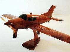One of the most Popular Models of General Aviation Aircraft, this Solid Mahogany Beechcraft Bonanza is a Wonderful Scale Model Replica of the real thing! This Handcrafted Design is Finely Detailed with Movable Props and Three Coats of Polyurethane Finish add High Gloss on a Rich Wood Grain.  Dimension: Length: 17, Wing Span: 20.  Stand included.  This is not an ordinary Wood Toy. It is Made of Solid Natural Mahogany Wood. Handmade with HIgh Quality Gift for someone whom you love the most. It…