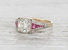Antique Edwardian engagement ring made in 18k yellow gold and platinum. Centered with a GIA certified 1.16 carat old European cut diamond with K color and VVS2 clarity. Accented with natural rubies. Circa 1915.