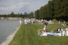 On Bastille Day in France, everyone wears white and picnics outdoors.  Very elegant!  This photo is on the grounds of Versailles.  I want to be in France on July 14th!
